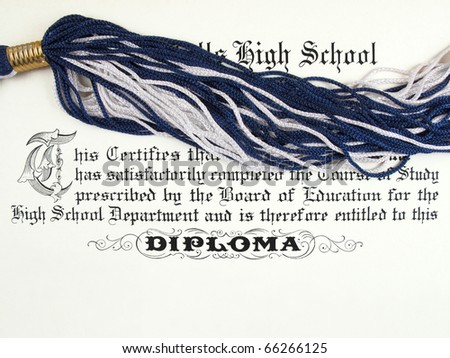 Close up detail of a high school diploma with tassel from cap - stock photo