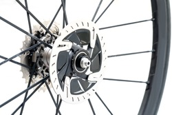 Close up Detail of a New hydraulic disk brake for road bike. New roadbike disc brake on white background.