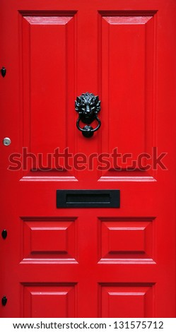 Close-Up Detail of a Red Front Door of a London Town House