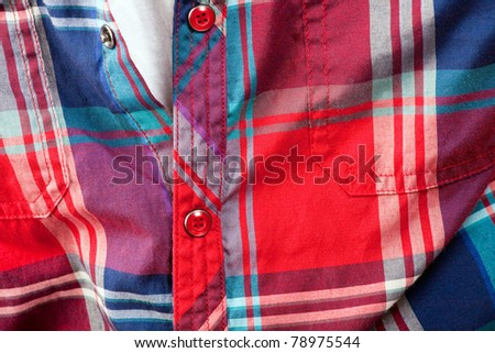 Close up detail of a red plaid button up style shirt. #78975544