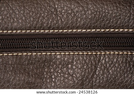 close up detail of a zipper on black leather bag