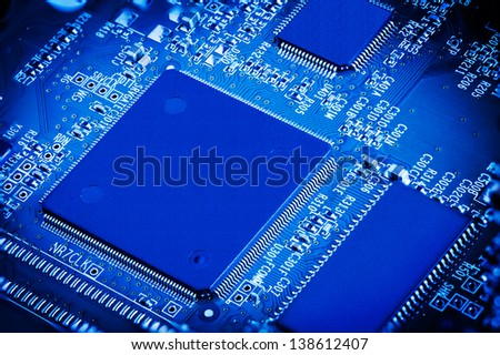 Close up detail of blue microchip circuit board.