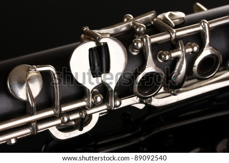 close up detail of clarinet on black background