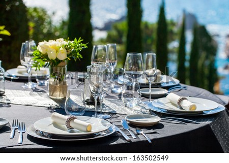 Close up detail of elegant served table outdoors.