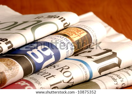 close-up detail of international newspapers