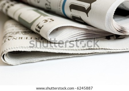 close up detail of international newspapers - stock photo