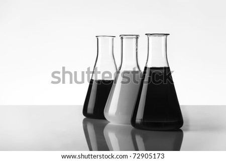 close up detail of laboratory beakers with different liquid in them