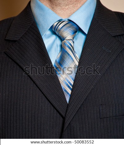 striped tie with a striped shirt. Blue shirt, striped