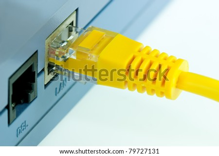 Close up Detail of  RJ45 Yellow Network Cable Connected To Wireless Router