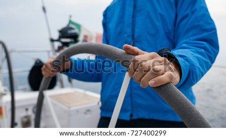 Close up detail of skipper woman hands portrait on sailing boat.