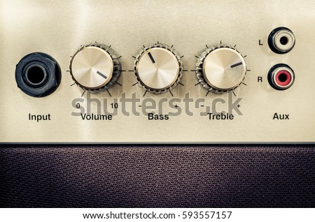Close-up detail of sound volume controls in vintage style