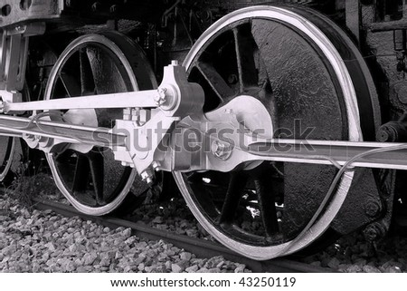 Close up Detail of Steam Train Wheels in Black and White