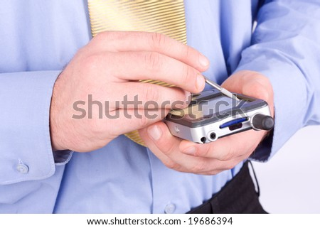 Close-up detail of the hands of a businessman tapping on a pda computer