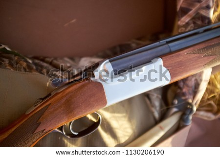 Close Up Detail of Wooden and Metal Shot Gun with Detailing, Showing Trigger and Barrels Outdoors #1130206190