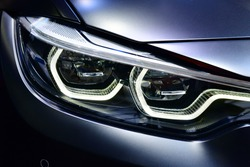 Close up detail on one of the LED headlights modern car.
