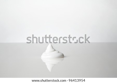 close up detail shot of shaving cream on a white background