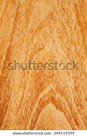 Close up detail view of a textured teak wood background with a golden rich color. Carpentry and organic natural materials and pattern backdrop. Full frame cut of wood with vertical lines and knots.