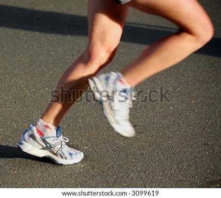 Close up detail view of athletes legs and feet, competing in a Marathon race