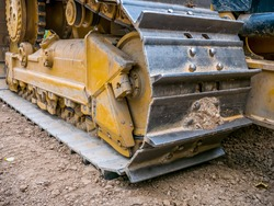 Close up detail with chain tracks of a bulldozer