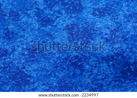 Close up, detailed macro of fabric with rich blue swirls.