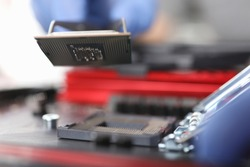 Close-up details chip on an electronic device. Microprocessor electronic units. Protection electrical equipment. Repair microprocessor electronics electrical equipment. Testing devices