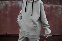 close up details of oversized green color hoodie at model.fashion and wear concept.warm oversize wear.space for text and logo.close up details of oversize wear.horizontal banner wear.celadon suit