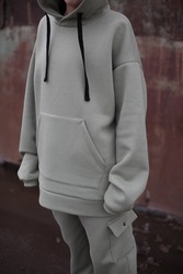 close up details of oversized green color hoodie at model.fashion and wear concept.warm oversize wear.space for text and logo.close up details of oversize wear.vertical banner wear.celadon suit