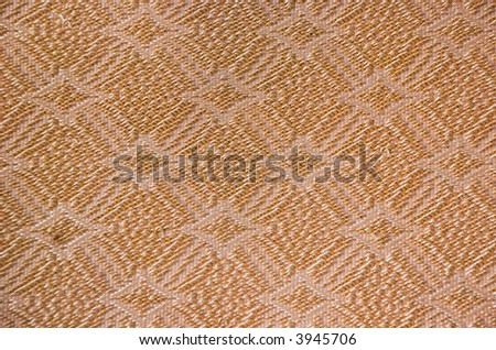 close up diamond or flower like fabric pattern in old couch material