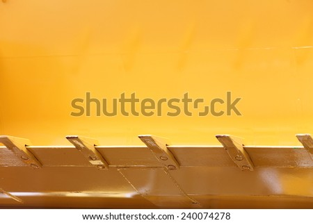 Close up digger excavator bucket bulldozer shovel yellow industrial background