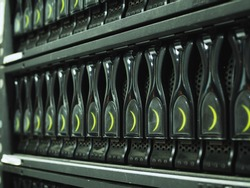 Close-up disk storage blades in mainframe server room