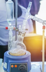 close up distillation set flask two neck equipment for separating the component substances from liquid mixture with evaporation and condensation in chemistry laboratory
