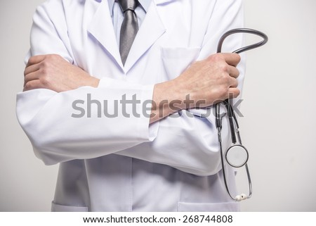 Close-up. Doctor hands crossed with stethoscope.