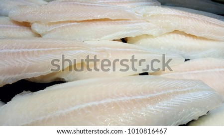 Close up dory fillet sliced on ice bucket or frozen dory fillet in grocery store use for raw food background