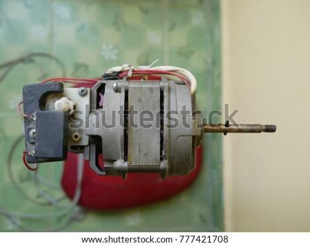 Close up dust on motor of electric fan, Maintenance electric fan #777421708
