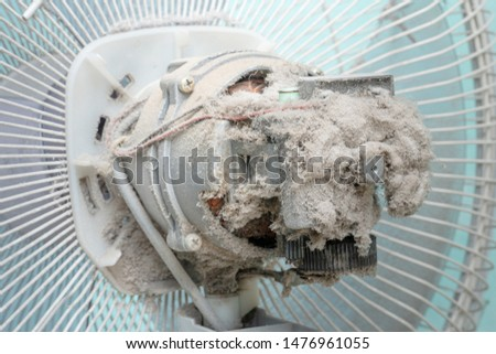 close up Dust on system air conditioner or electric fan, Not cleaned, cause of allergy, virus concept