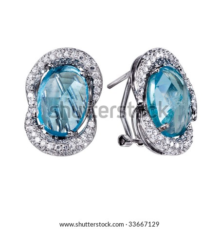 Close-up earrings with zircon and expensive big blue  gemstones