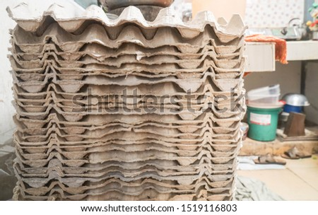 close up egg cartons in kitchen