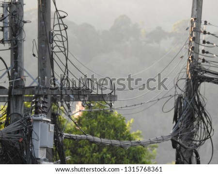 Close up Electrical poles of high voltage,Electric transformer on electric pole,electric pole power lines and wires #1315768361