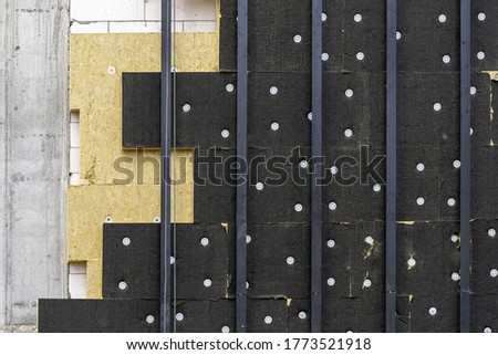 Close up element of new building under construction with rock wool insulation panel on exterior. Architecture concept