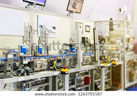 close up emergency stop switch and programmable logic controller plc of high performance automatic manufacturing assembly and inspection process at production line