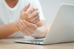 close up employee man massage on his hand and arm for relief pain from hard working ,carpal tunnel syndrome concept