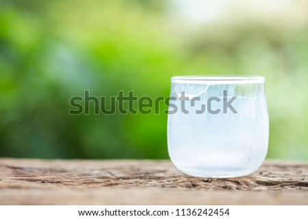 Close up empty glass of milk after drinking on wooden table with space blur background for text #1136242454