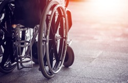 Close-up Empty wheelchair in front of the Outpatient Department of Hospital with sunlight