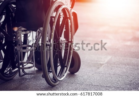 Close-up Empty wheelchair in front of the Outpatient Department of Hospital with sunlight #617817008