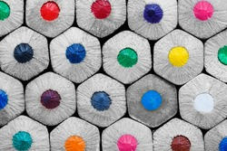 Close-up ends of hexagonal colored pencils. Macro photography.