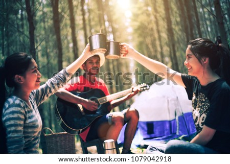 Close Up. Enjoy breakfast and music young asian hipster in travel camping trip. camp forest adventure travel remote. relax and travel concept. #1079042918