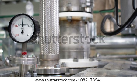 Close up equipment or pressure gage  for petrochemical plant , System technology future . Selective focus #1082173541