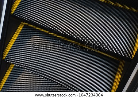 Close up Escalator Staircase made with steel groove rail and anti slip pattern