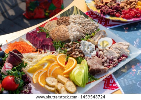 close-up. Exhibition, sale of the products. Street festival of food. Concept Picnic, Holiday, Festivities. sweets. Sliced fruits and dried fruits
