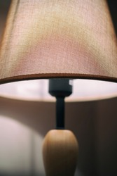 close-up fabric cover table lamp, light on, vertical frame, copy space